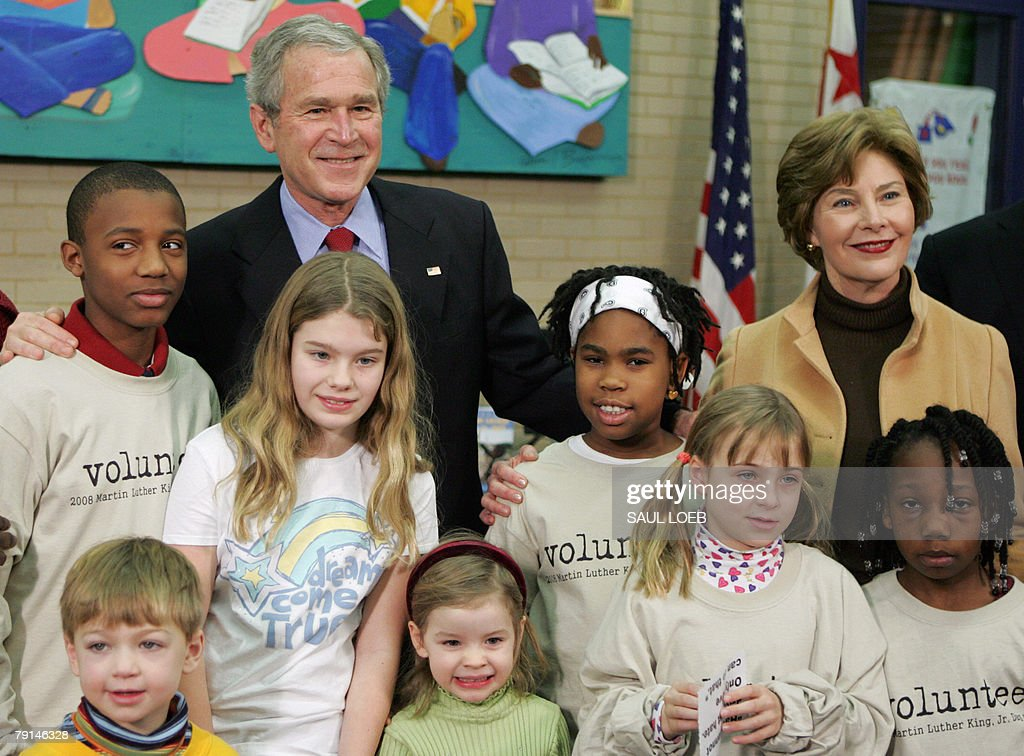 US President George W. Bush (2nd L), with First Lady Laura Bush (R) stand with young children after participating in a lesson on the importance of Martin Luther King, Jr. Day during a tour of the Martin Luther King, Jr. Memorial Library in Washington, DC, 21 January 2008.