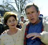 President George W Bush with First Lady Laura Bush stop outside Crawford Texas' Coffee Stop answering questions from the media on Iraq and Saddam...