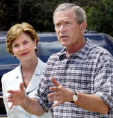 President George W Bush with his wife Laura at his side takes a few minutes from his vacation in Crawford Texas to update the media on a variety of...