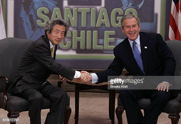 US President George W Bush with Japanese Prime Minister Junichiro Koizumi at their bilateral meeting in Santiago November 20 2004 during the annual...
