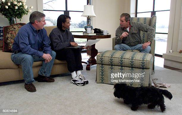 President George W Bush working w Chief of Staff Andrew Card and National Security Advisor Dr Condoleezza Rice at President's Crawford Texas ranch...
