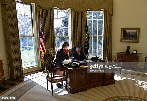 President George W Bush works on his State of the Union address in the Oval Office