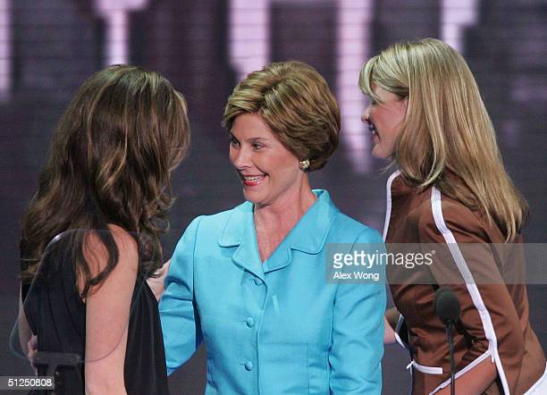 President George W Bush's daughters Barbara and Jenna introduce their mother US First lady Laura Bush on night two of the Republican National...