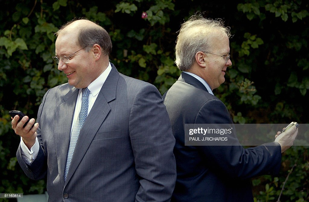 President George W Bush's Deputy Chief of Staff Joe Hagen and Senior Advisor Karl Rove keep up to date on their Blackberry pagers while waiting in...