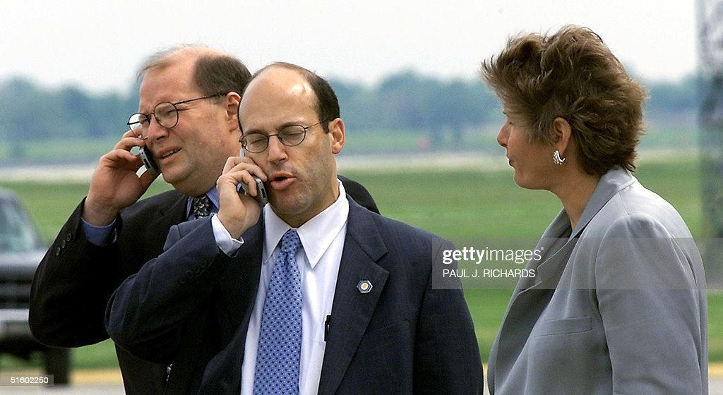 US President George W. Bush's Deputy Chief of Staff Joe Hagin(L) and White House Press secretary Ari Fleischer(C) work their cellphones as Counselor to the President Karen Hughes(R) listens moments after the President landed in Cleveland, Ohio, shortly after the 24 May 2001 press conference by US Senator James M. Jeffords(I-VT) announcing his leaving of the Republican party and causing a variety of shifts in power on Capitol Hill. AFP PHOTO/ Paul J. RICHARDS