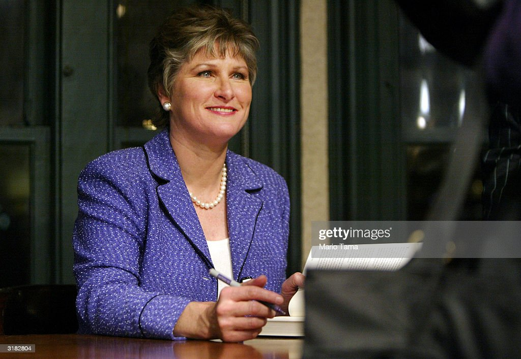 President George W Bush's longtime counselor Karen Hughes signs her new book 'Ten Minutes from Normal' March 31 2004 in New York City Hughes will...