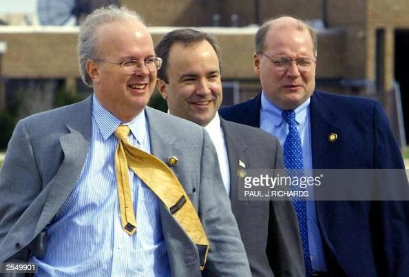 US President George W Bush's Senior Adviser Karl Rove Press Secretary Scott McCellan and Deputy Chief of Staff Joe Hagin walk to Air Force One at...