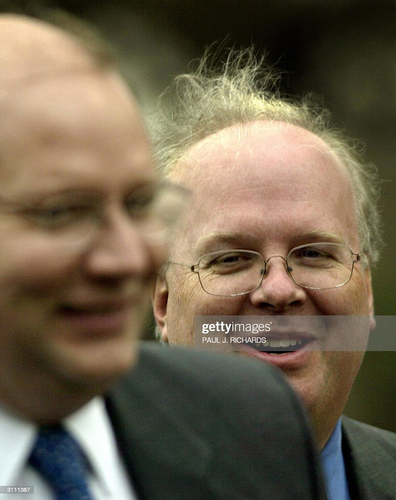 US President George W. Bush's Senior Advisor Karl Rove(R) follows closely behind White House Deputy Chief of Staff Joe Hagen (L) on the South Lawn of the White House as they return with the President 18 March, 2004 from Ft. Campbell, Kentucky, where the President had lunch with soldiers. AFP Photo/Paul J. RICHARDS