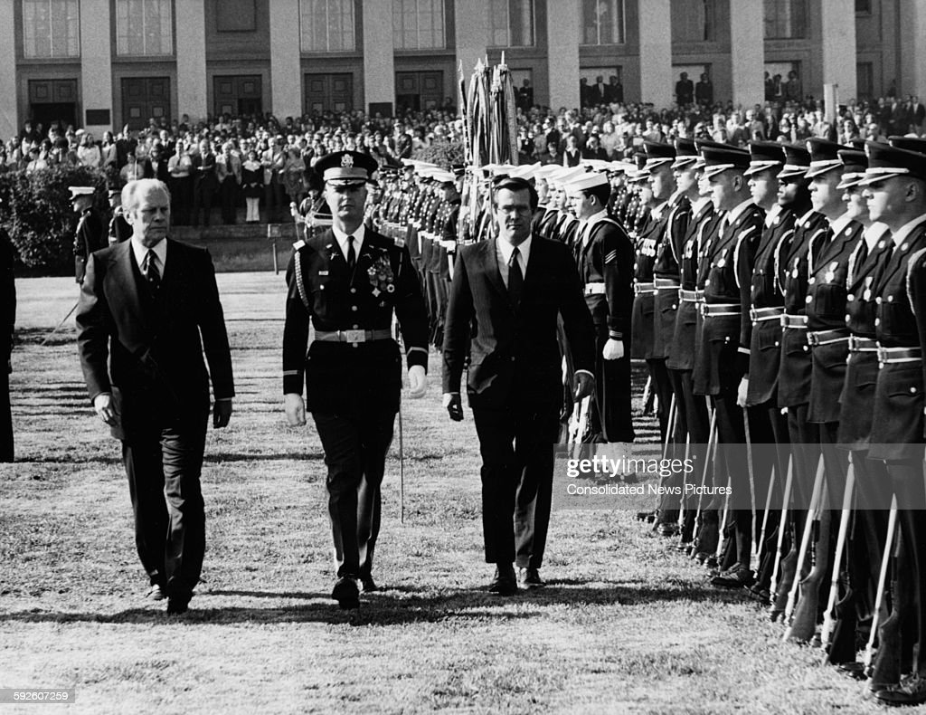 US President Gerald Ford and Donald Rumsfeld the new Secretary of Defense reviewing a line of troops on the lawn of the Pentagon Washington DC...