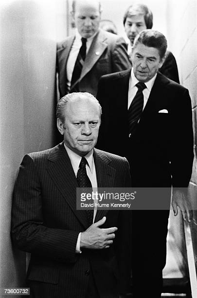 President Gerald Ford and his party opponent Ronald Reagan walk tersefaced from a late night meeting the two had in Reagan's Kansas City MO hotel...