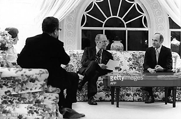 President Gerald Ford and US Secretary of State Henry Kissinger are briefed by National Security Adviser Brent Scowcroft on the evacuation of Saigon...