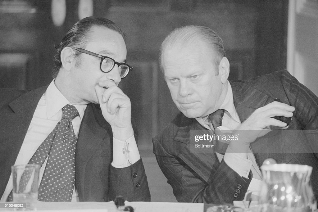 President Gerald Ford huddles with Alan Greenspan the new Chairman of the Council of Economic Advisers at the White House on September 5 1974 They...