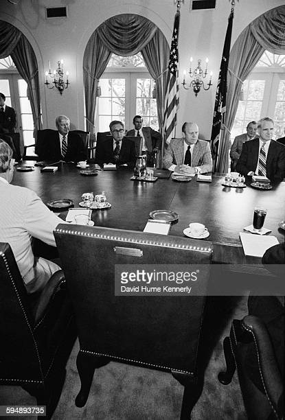 President Gerald Ford leads his first cabinet meeting following the resignation of former President Richard Nixon the day before in the White House...