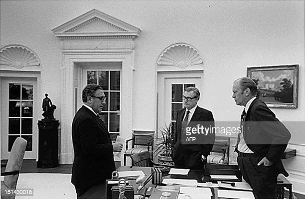 President Gerald Ford US Secretary of State Henry Kissinger and Vice President Nelson Rockefeller discuss the evacuation of Saigon 28 April1975 at...
