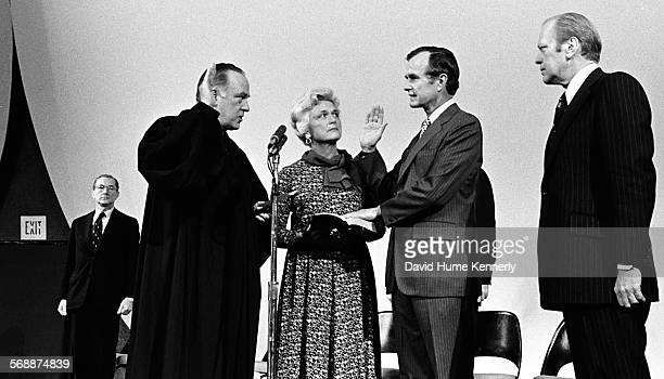 President Gerald R Ford and Barbara Bush watch as Justice Potter Stewart swears in George HW Bush as the new Director of the CIA at CIA HQ in Langley...
