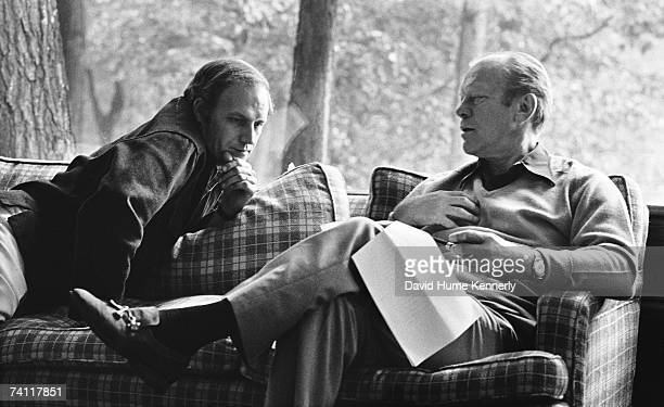 President Gerald R Ford and Chief Of Staff Dick Cheney look over documents in the living room of the Aspen Lodge during a weekend trip to Camp David...