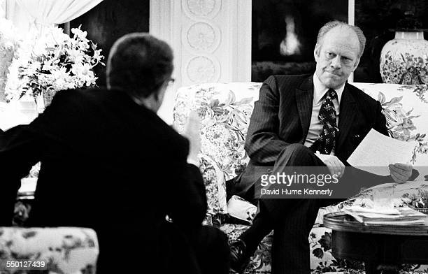 President Gerald R Ford meets with Secretary of State Henry Kissinger to discuss the progress of the evacuation from Saigon in the 2nd floor family...
