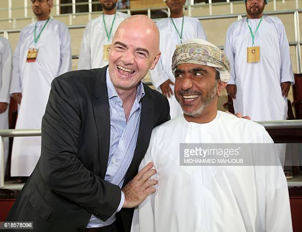 FIFA president Gianni Infantino and chairman of the Oman Football Association Salem bin Said alWahaibi arrive to attend the Omani league football...