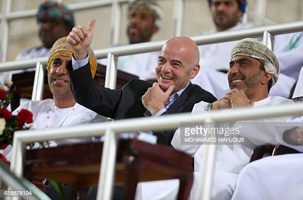 FIFA president Gianni Infantino and chairman of the Oman Football Association Salem bin Said alWahaibi wait before the start of the Omani league...