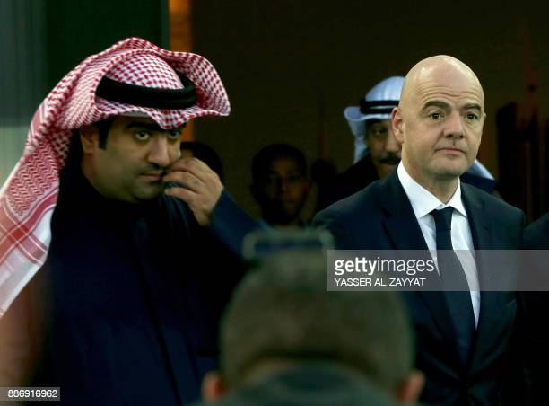 FIFA president Gianni Infantino and Kuwait's Minister of Youth Affairs Khaled AlRawdhan speak with Kuwaiti youth during a tour of the Sheikh Jaber...