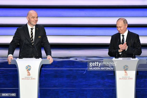 FIFA president Gianni Infantino and Russian President Vladimir Putin speak on stage ahead of the Final Draw for the 2018 FIFA World Cup football...