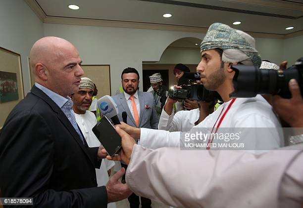 FIFA president Gianni Infantino answers journalists' questions before the start of the Omani league football match between alShabab and Sohar on...