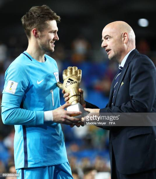 President Gianni Infantino awards goalkeeper Freddie Woodman of England with the Golden Glove Award after the FIFA U20 World Cup Korea Republic 2017...