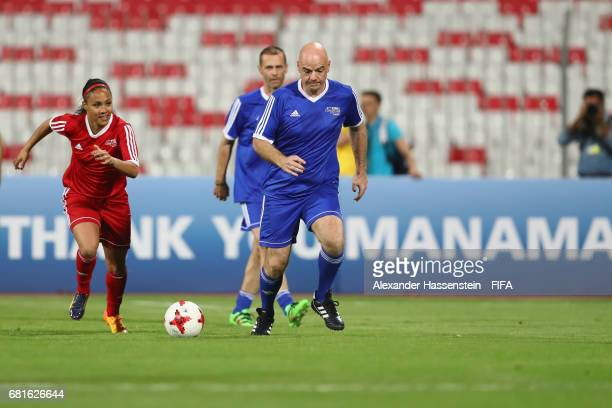 President Gianni Infantino battles for the ball with FIFA Legend Alex Scott during a FIFA Football Tournament ahead of the 67th FIFA Congress at...