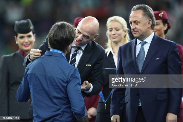 President Gianni Infantino congratulates head coach Joachim Loew of Germany after the FIFA Confederations Cup Russia 2017 final between Chile and...