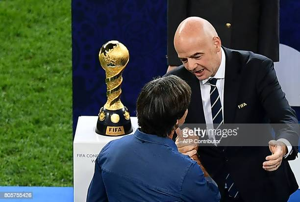 President Gianni Infantino congratultes Germany's coach Joachim Loew after Germany won the 2017 Confederations Cup final football match between Chile...