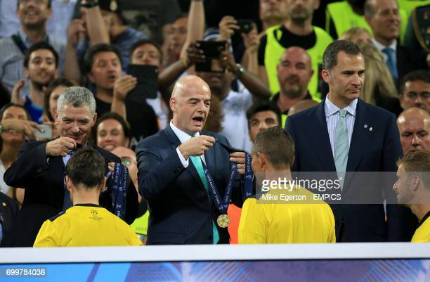 FIFA president Gianni Infantino during the medal award ceremony to the match officials after the game
