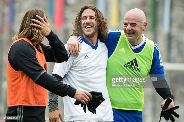 FIFA president Gianni Infantino embraces Carles Puyol during a FIFA Team Friendly Football Match at the FIFA headquarters prior to The Best FIFA...
