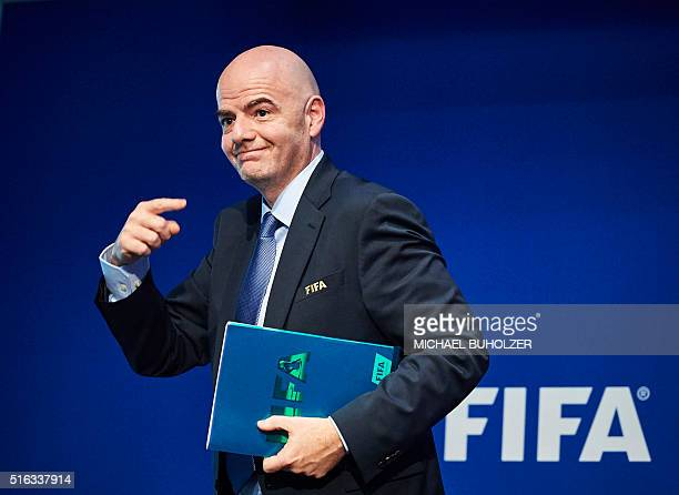 President Gianni Infantino gestures as he leaves a press conference following an executive meeting of the world football governing body at its...