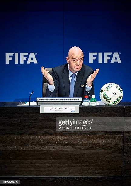 President Gianni Infantino gestures during a press conference following an executive meeting of the world football governing body at the FIFA...