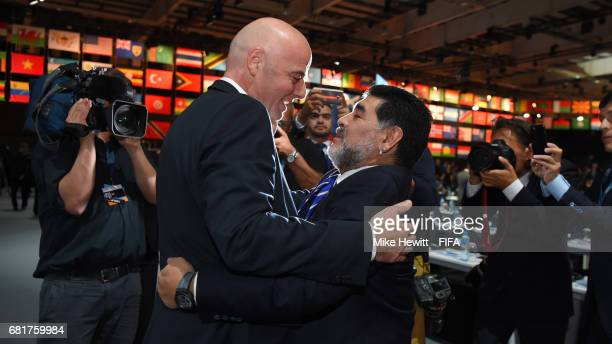 President Gianni Infantino greets FIFA Legend Diego Maradona ahead of the 67th FIFA Congress at the Bahrain International Exhibition Convention...