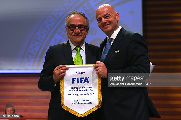 President Gianni Infantino hands over the FIFA penant to Decio De Maria President of the Mexican Football Federation during the 66th FIFA Congress at...