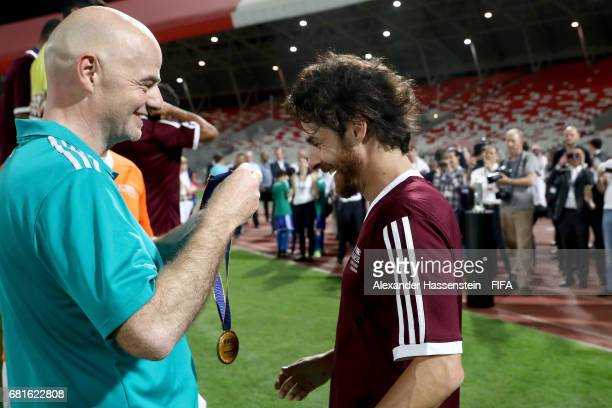 President Gianni Infantino hands over the winners trophy to Pablo Aimar of the Bahrain Football Association after the FIFA Football Tournament ahead...