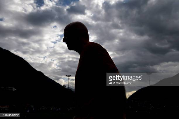 President Gianni Infantino is seen in silhouette during 'The Gianni's game the match of legends' a football match with football legends in honour of...