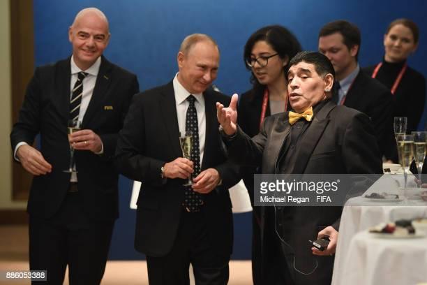 FIFA president Gianni Infantino looks on as Vladimir Putin President of Russia speaks to Maradonna prior to the Final Draw for the 2018 FIFA World...