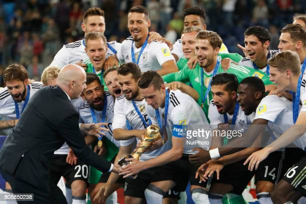 President Gianni Infantino presents the trophy to Germany national team players during award ceremony after FIFA Confederations Cup Russia 2017 final...