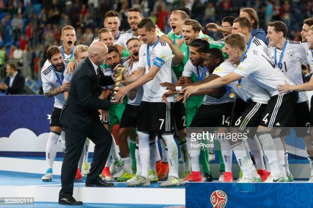 President Gianni Infantino presents the trophy to Julian Draxler of Germany national team during award ceremony after FIFA Confederations Cup Russia...