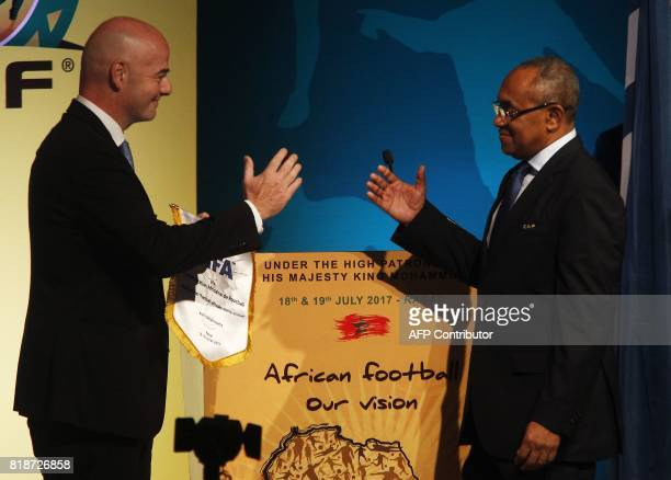 President Gianni Infantino shakes hands with president of the African Football Confederation Ahmad Ahmad during the first ever African Football...