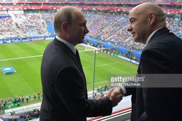 FIFA president Gianni Infantino shakes hands with Russian President Vladimir Putin ahead of the 2017 Confederations Cup group A football match...