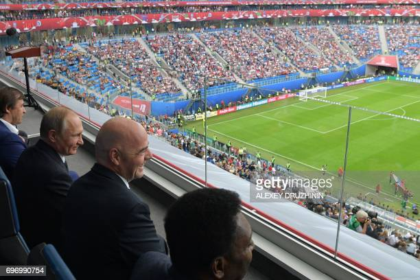 President Gianni Infantino sits next to Russian President Vladimir Putin as they attend the 2017 Confederations Cup group A football match between...