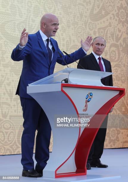 President Gianni Infantino speaks as Russian President Vladimir Putin looks on during the opening of the trophy tour ceremony at Luzhniki stadium in...