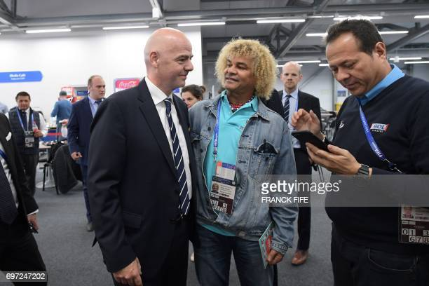 FIFA president Gianni Infantino speaks with Colombia's former midfielder Carlos Valderrama ahead of the 2017 Confederations Cup group A football...