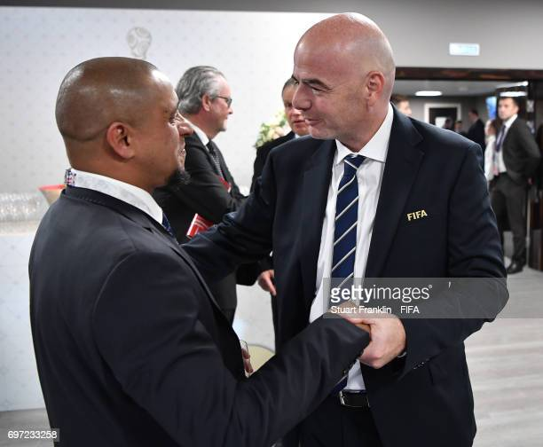 President Gianni Infantino talks with football legend Roberto Carlos at the FIFA Confederations Cup Group A match between Russia and New Zealand at...