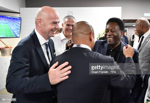 President Gianni Infantino talks with football legends Pele and Roberto Carlos at the FIFA Confederations Cup Group A match between Russia and New...