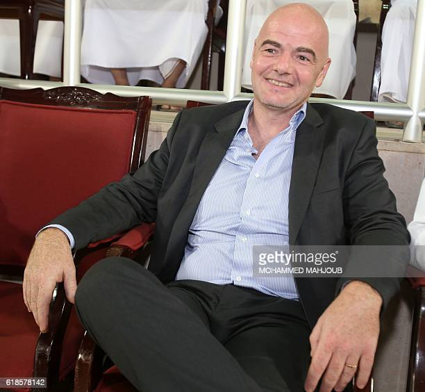 FIFA president Gianni Infantino waits before the start of the Omani league football match between alShabab and Sohar on October 27 2016 at alSeeb...