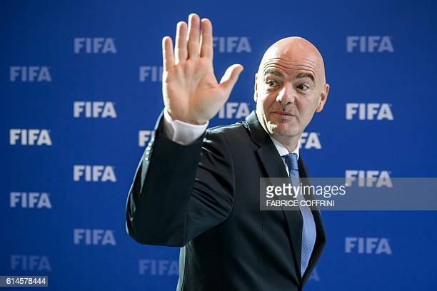 FIFA president Gianni Infantino waves as he leaves after a meeting of the FIFA Council on October 14 2016 at the world football's governing body...